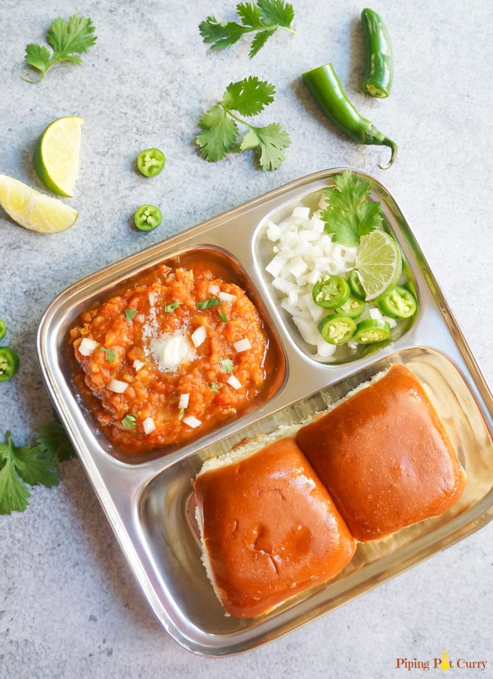 Pav Bhaji is a popular Indian street food, made with potatoes and vegetables cooked in a tomato base & enjoyed with dinner rolls. Try this one-pot recipe made in 30 minutes & you will not make it any other way again!