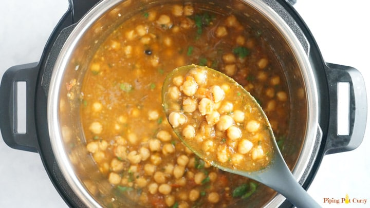 Pressure cooker Chole Masala cooked in a ladle over the instant pot