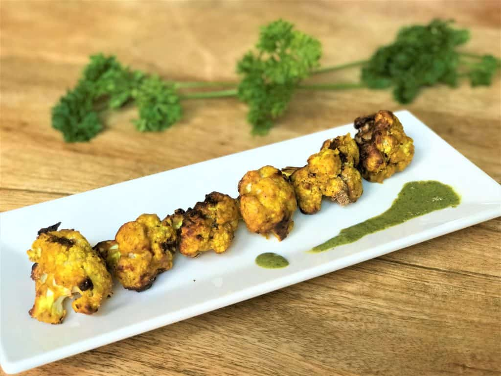 Air Fryer Tandoori Gobi or Cauliflower Tikka Bites is a great snack or appetizer.  Especially for game day or if you are entertaining guests