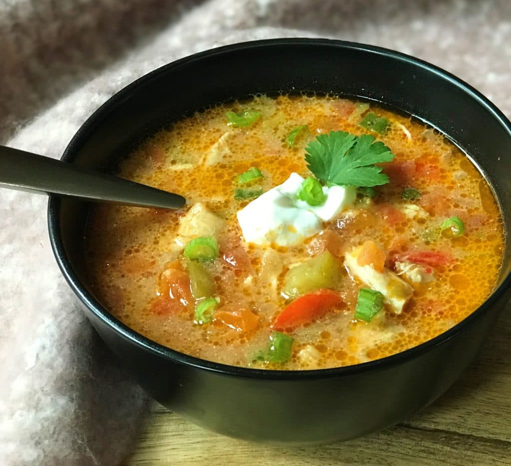 Chicken Fajita Soup made in theInstant Potor Pressure Cooker. A delicious and healthy soup with tender chicken, lots of veggies and spices.