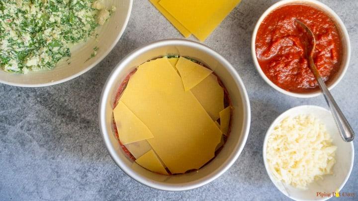Spinach Artichoke Lasagna - Instant Pot 3. Layer marinara then pasta