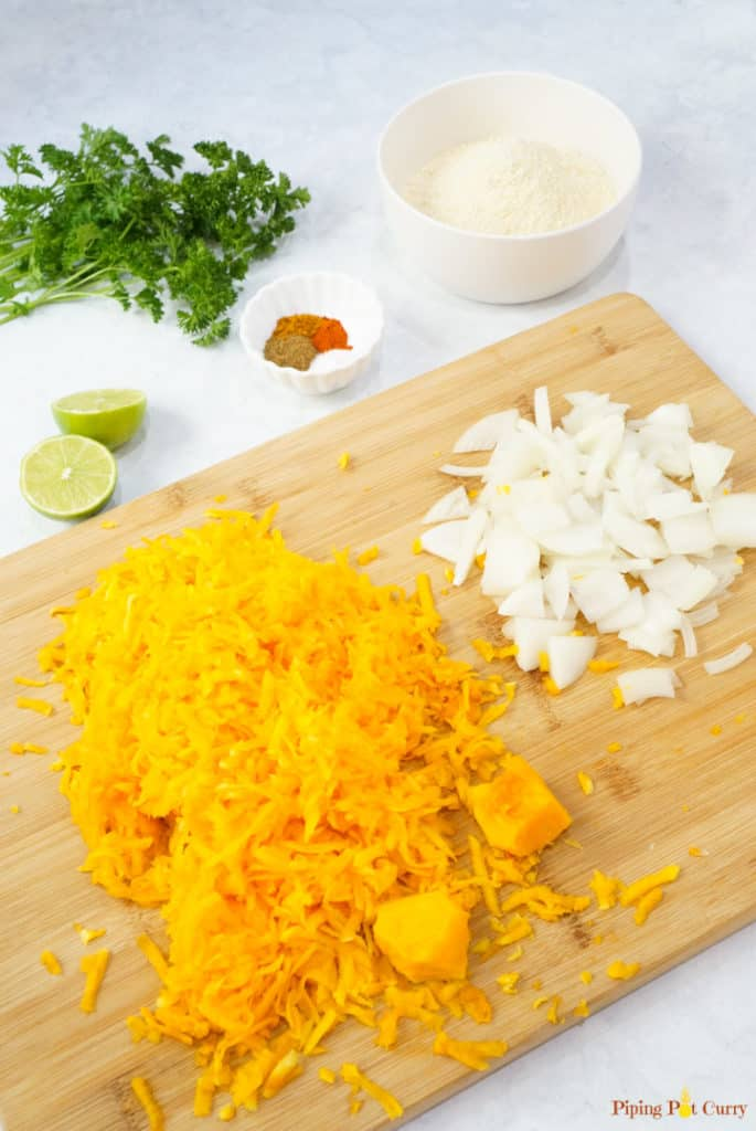 Vegan Pumpkin Fritters - Ingredients grated butternut squash, onions, chickpea flour, spices, lemon, parsley