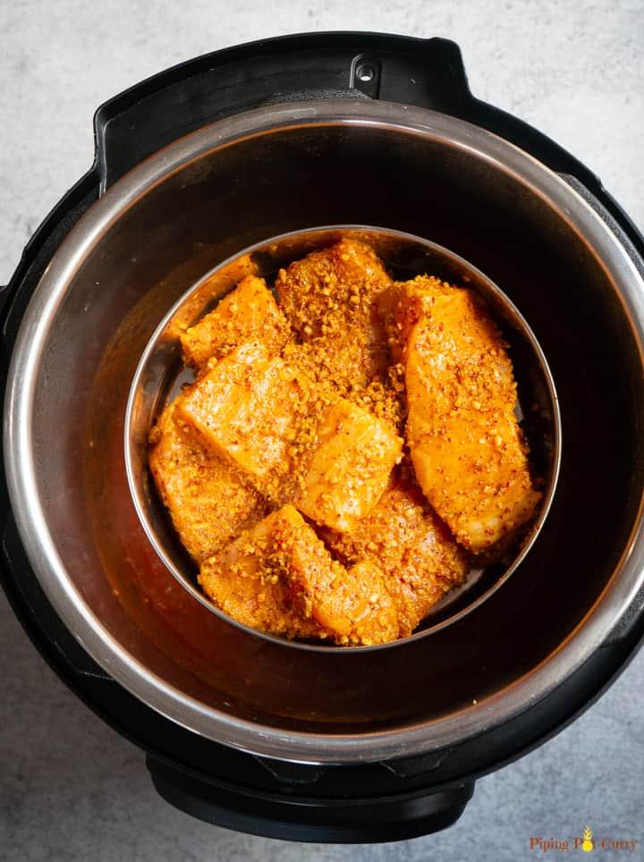 Instant Pot Salmon Tikka Masala - Step 3 Place marinated salmon pot-in-pot