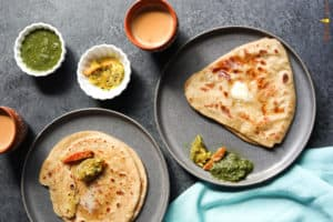 Paratha. Indian flatbread - Piping Pot Curry.