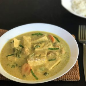 Thai Green curry served in a white bowl