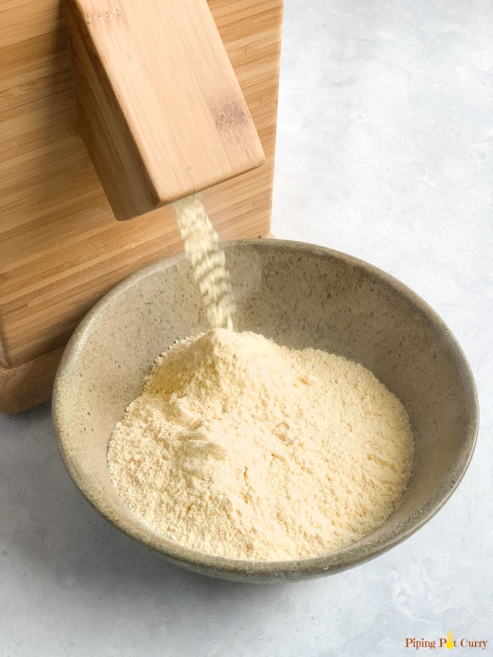 Chickpea flour coming of a stone mill