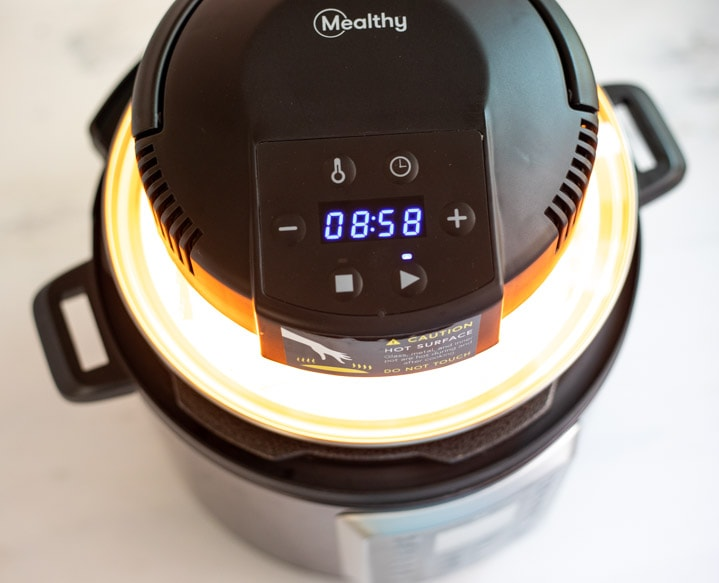 Mealthy Crisplid on top of the electric pressure cooker